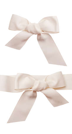 white bow: Decorational two white bow isolated over white background.