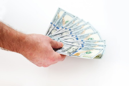 fanned: hand of man holding fanned fistful dollars bills. Stock Photo