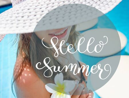Woman in white hat standing close up and letters Hello Summer.
