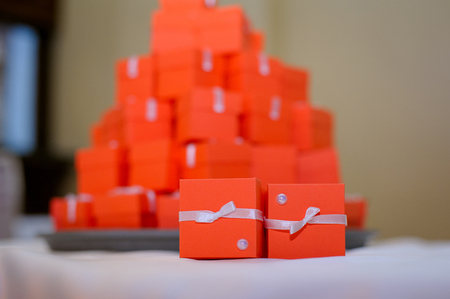 wedding guest: Red boxes for guest attending the wedding. Stock Photo