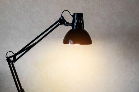 turn table: Vintage black reading table lamp turn on in room.