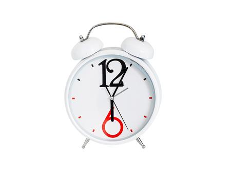 beat the clock: Analog desktop clock isolated on white background. Stock Photo
