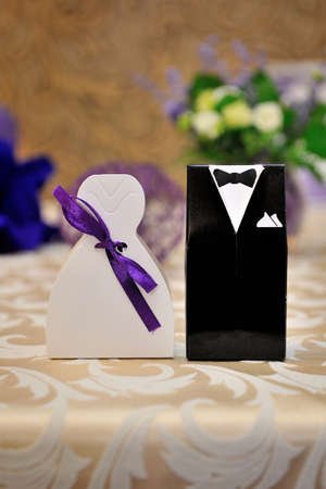 bonbonniere: Two bonbonniere with image of groome and bride Stock Photo