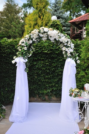 Wedding arch with white flowers for ceremony stock photo picture wedding arch with white flowers for ceremony stock photo picture and royalty free image image 54873731 mightylinksfo