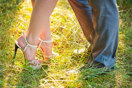 stay in the green: bride and groom stay on green grass