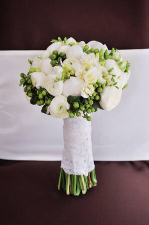 white wedding bouquet of bride on table background