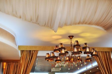 crystal chandelier: beautiful crystal chandelier in luxury interior of hotel