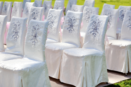 wedding chairs: white Wedding chairs for ceremony in summer park. Stock Photo