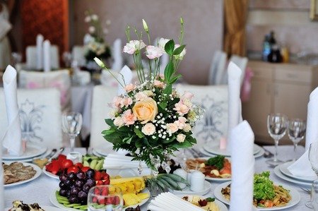 entertaining area: bridal wedding bouquet on the table in restaurant