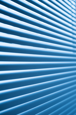 the shutter: modern blue plastic Shutter Blinds in room close-up Stock Photo