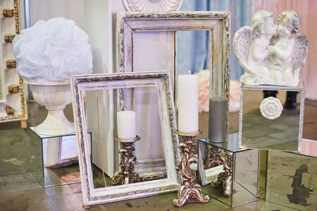 photo studio: old photo frames and candles with decorations for photo studio. Stock Photo