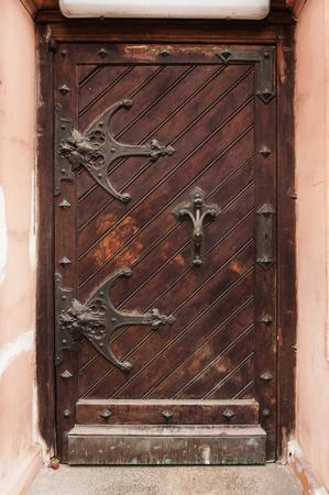 canopies: old wooden door with metal canopies in historical building.