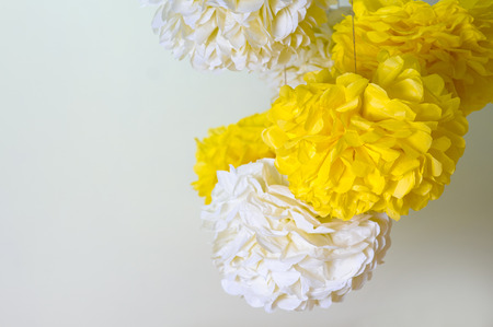 a place for the text: yellow and white paper pompons and a place for text. Stock Photo