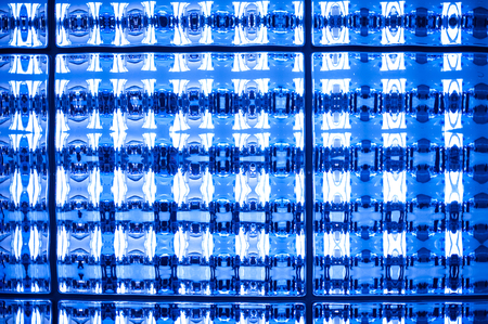 diagonals: Abstract blue tone stained mosaic pixel texture wallpaper background.