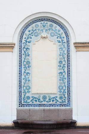 stucco facade: architectural arch on the facade of the building with blue stucco with space for text. Stock Photo
