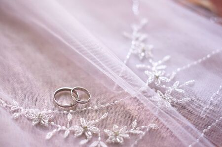 weddingrings: gold rings bride and groom on the veil. Stock Photo