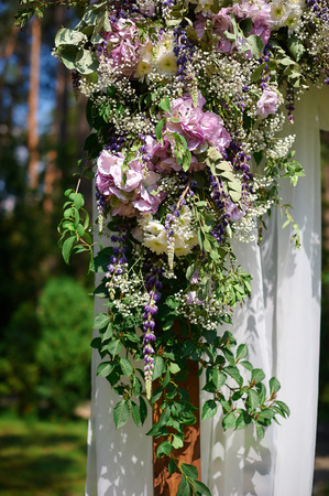 Wedding Arch Decorated With Flowers And Glass Hanging Vases Stock