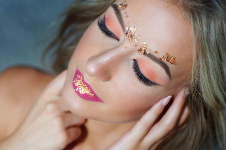 Beautiful Fashion Luxury Makeup, long eyelashes, perfect skin facial make-up. Beauty Brunette model woman holiday make up close up Stock Photo