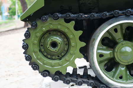 Tracks of the tank on a pedestal close up.