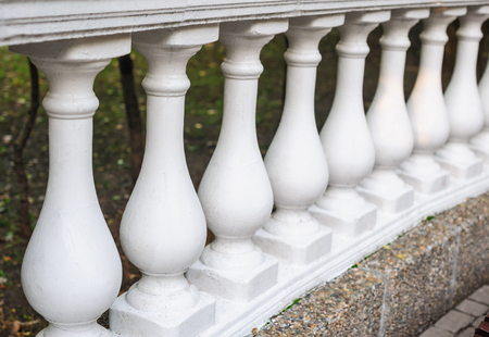 bannister: white balusters made of cement, architectural element. Stock Photo