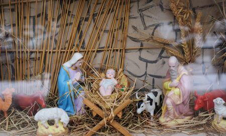 infant jesus: Christmas decor Mary and Joseph near the infant Jesus in the manger.