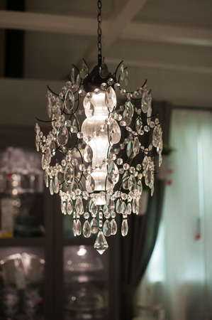 luxurious: luxurious chandelier in the living room interior