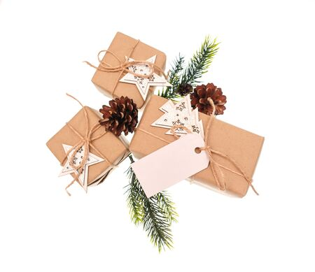 tied: gift boxes tied with a rope with wooden stars on white background. Stock Photo