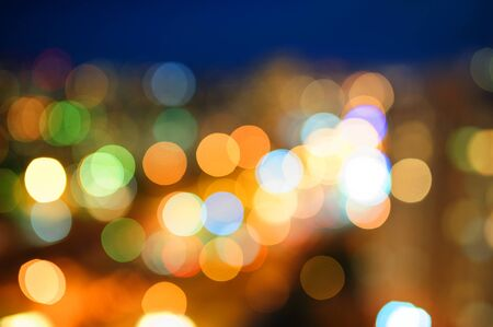 multicolored blurry lights of the night city.