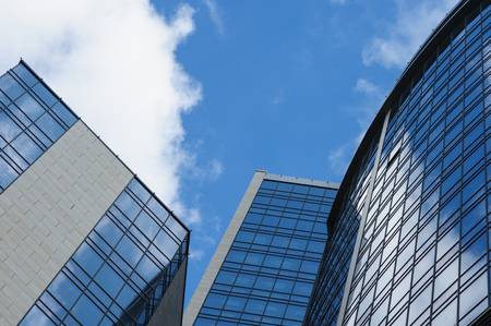 multistory glass office building on a background of the sky.