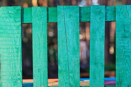 picket green: Green wooden fence in the summer village