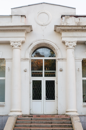 White facade with doors and columns in front Stock fotó