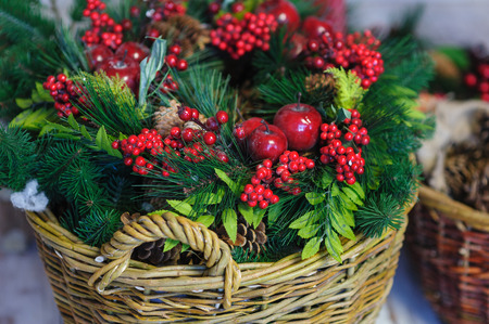 piny: Christmas Decor basket with fir branches and red apples Stock Photo