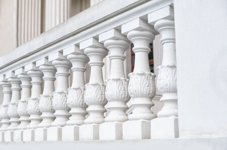 White balustrade on the restored facade of the building