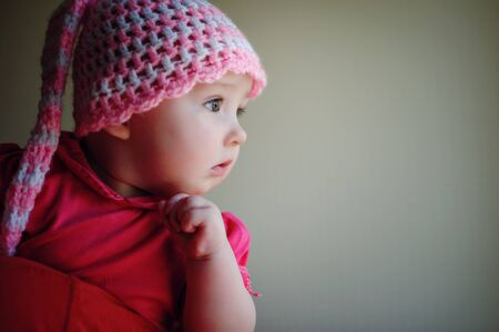 little girl in pink knitted hat Stock Photo