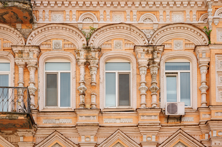 multi-story historic building with windows
