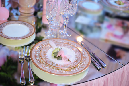 entertaining area: beautiful tableware in the restaurant for a wedding banquet