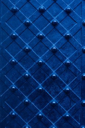 blue metal texture door with rivets Reklamní fotografie
