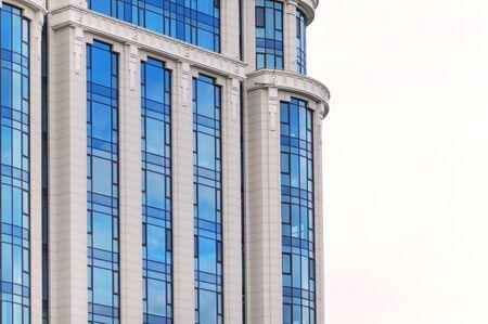multistorey: multi-storey glass skyscraper office building on a white background