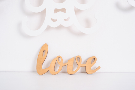 wooden word love on a white background in studio Stock Photo