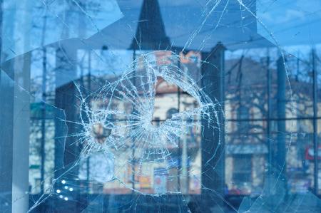 pierce: bullets pierced glass in the window