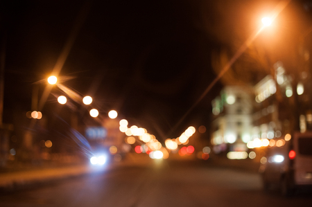 Night city street lighting lanterns and cars Stock Photo