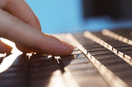 female fingers on the laptop keyboard