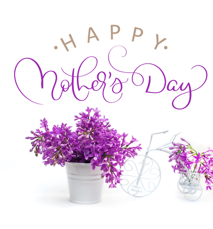 lilac flowers on a white background decorated with small bike and text Happy mothers day. Calligraphy lettering hand draw