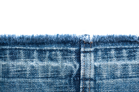 Fabric texture of jeans and white background with place for text