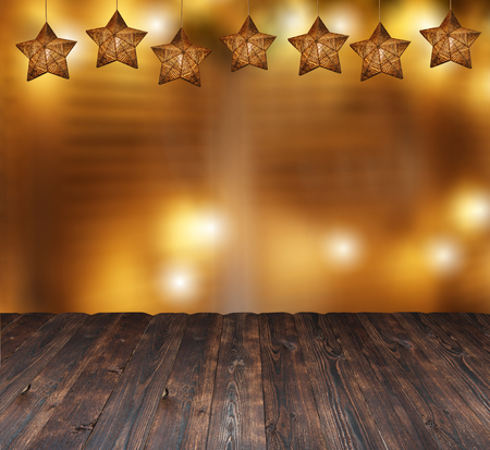 beautiful Christmas stars and blurred candle lights. Place for text on a wooden background