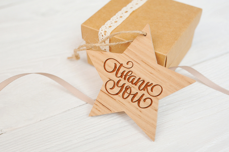 borne fontaine: text thank you on wooden star and box, Thanksgiving Day you card Banque d'images