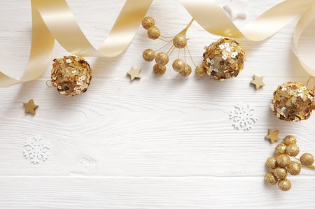 Mockup Christmas decor top view and gold ball, flatlay on a white wooden background with a ribbon, with place for your text