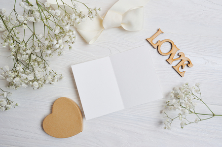 mockup Letter with a calligraphic pen greeting card for St. Valentines Day in rustic style with place for your text, Flat lay, top view photo mock up Stock Photo