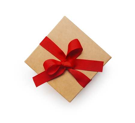 Wrapped vintage gift box with red ribbon bow, isolated clipping mask on white background, top view Stock Photo