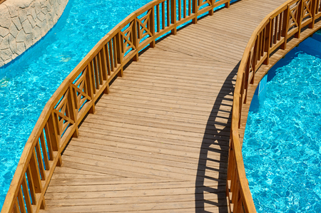 swimming pool with wooden bridge, travel concept in Egypt, Sharm El Sheikh